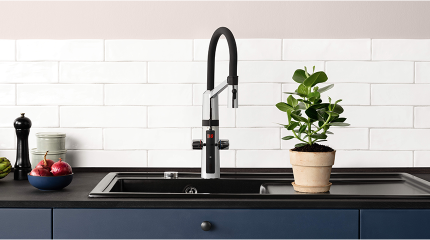 Kitchen faucet with high, movable spout can be handy in washing large pots and pans.
